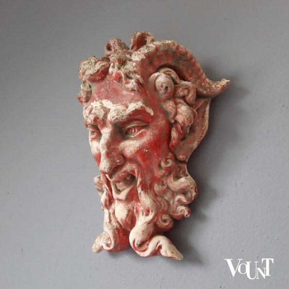 Oud zandstenen ornament sater- / satyr-hoofd